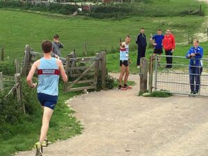 Ian Carley waits to receive baton from Richard Lovejoy at 2016 South Downs Relay