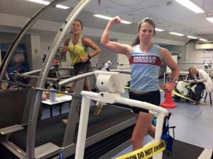 Suzie Chan attempting theworld 12hr treadmill record in 2016 with support from Charlotte Hanson