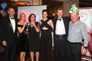 Some of the FROGLE team with trophy at 2017 Annual Awards Dinner