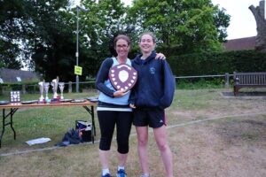 Eloise Stradling being presented with U23 trophy at 2017 Club Championship
