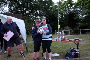 Linda Tyler being presented with trophy at 2017 Club Championship