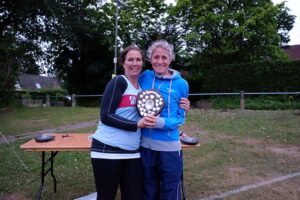 Sarah Hill being presented with trophy at 2017 Club Championship