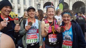Members with medals at end of 2017 London Marathon