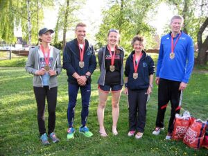 Members with medals back at Farnham after the 2017 London Marathon