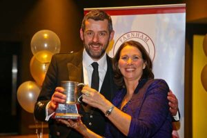 Stuart Williamson receives trophy at 2018 Annual Awards Dinner