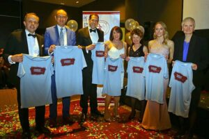 Craig Tate-Grimes, Damian Probett, Neil Ambrose, Kay Copeland, Linda Tyler, Kayleigh Copeland and Jane Georghiou presented with T-shirts at 2018 Annual Awards Dinner