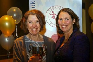 Jackie Wilkinson receives trophy at 2108 Annual Awards Dinner