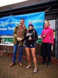 Suzie Chan receives trophy at Sri Chinmoy Annual Self Transcendence 24 track race