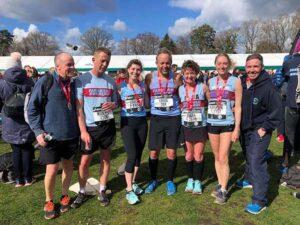 Members with medals at 2019 HRRL Fleet Half Marathon