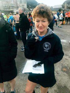 Linda Tyler with prize at 2019 HRRL Gosport Half Marathon