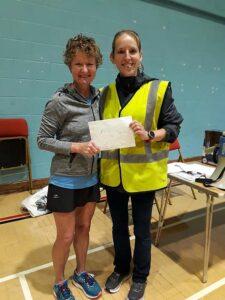Linda Tyler with prize at 2019 HRRL Solent Half Marathon
