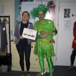 Helen Bracey presents Craig Tate-Grimes with 1st fancy dress prize at the 2020 Club Handicap