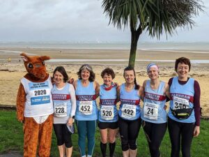 Ladies team with event mascot at 2020 HRRL Ryde 10