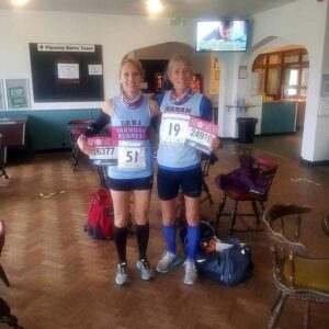 Emma Pearson and Sarah Hill with both 2020 Isle of Wight and London Marathon race numbers