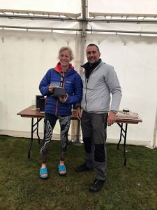 Sarah Hill receiving trophy at the North Downs Way 66 Pilgrim Challenge