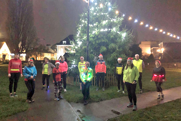 2020 Get Me Started course attendees and trainers at the Christmas tree in Gostrey Meadows in Farnham