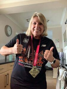 Carolyn Wickham with medal and T shirt after the 2020 Vitality 10km