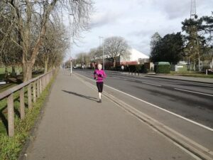 2021 Not Stubbington Green 10k - Jane Georghiou snapped in full flight by Sue Taylor running her virtual race