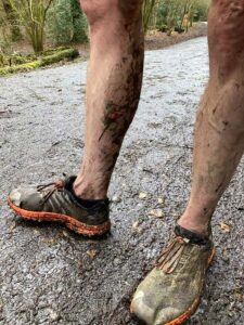 Muddy legs after a virtual cross country in 2021