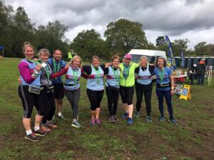 2021 - Woodland Woggle - A group of Farnham Runners show off their Woodland Woggle medals