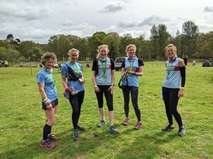 2021 - Woodland Woggle - A group of Fanham Runners celebrate after the finish