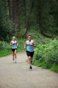 Kayleigh Copeland and Phil Hames running in the cross section of the 2021 Club Championship