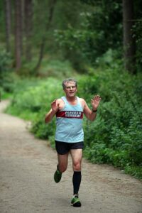 Mike Walberton running in the cross section of the 2021 Club Championship