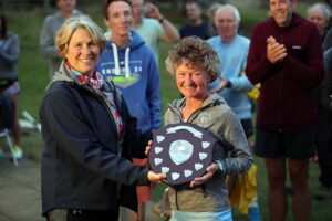Linda Tyler receives the F55 shield at the 2021 Club Championship