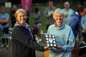 Jane Georghiou receives the F65 shield at the 2021 Club Championship