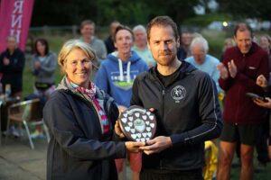 Nik Darlington receives the Senior Men's shield at the 2021 Club Championship