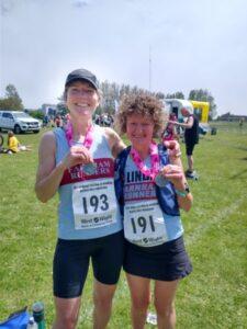 Lindsay Bamford and Linda Tyler with 2021 Needles Half Marathon medals